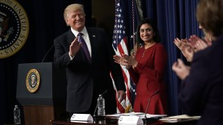 Donald Trump and Seema Verma appear during a 2018 panel