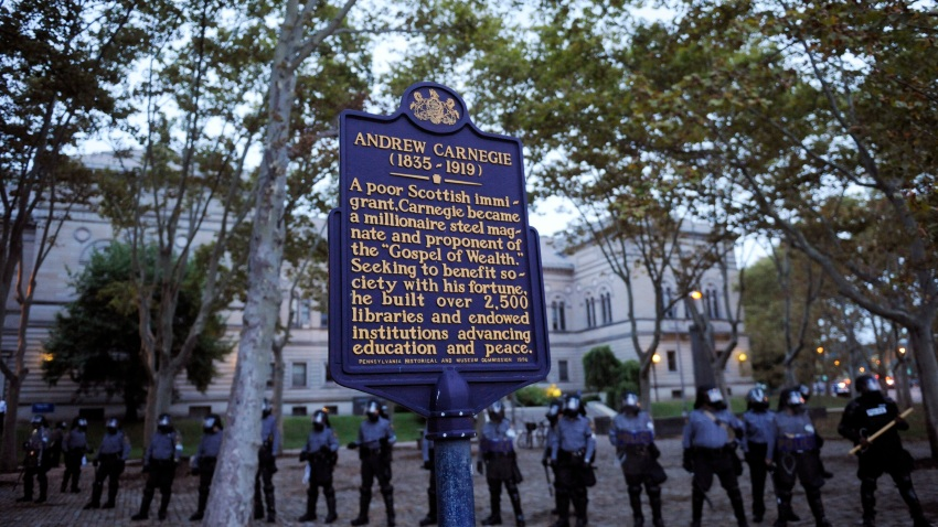 Police stand guard in front of the Carnegie Library while they try to disperse a crowd of students gathered in the Oakland section September 24, 2009 in Pittsburgh, Pennsylvania.