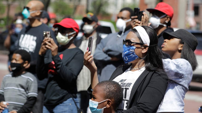 In this May 7, 2020, file photo, protesters listen during a rally after the shooting of Dreasjon Reed outside of the City County Building in Indianapolis.