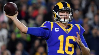 Quarterback Jared Goff #16 of the Los Angeles Rams drops back to pass over the defense of the Seattle Seahawks during the game at Los Angeles Memorial Coliseum on Dec. 8, 2019 in Los Angeles, California.
