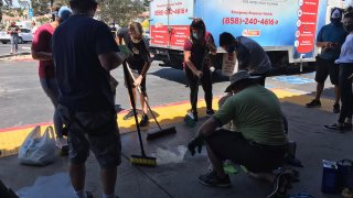 Community members seen cleaning up after the protests