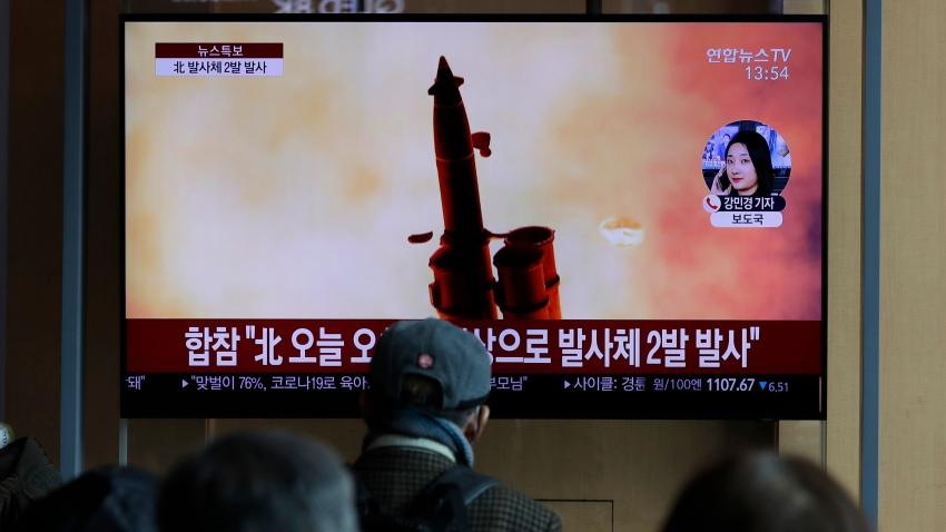 In this file photo, people watch a TV screen showing a news program reporting about North Korea's firing of projectiles with a file image at the Seoul Railway Station in Seoul, South Korea, Monday, March 2, 2020.