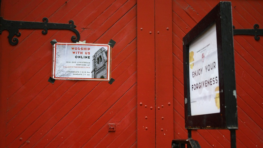 A flyer about online worship services is posted outside the Calvary Church during the coronavirus pandemic on May 6, 2020, in New York City.