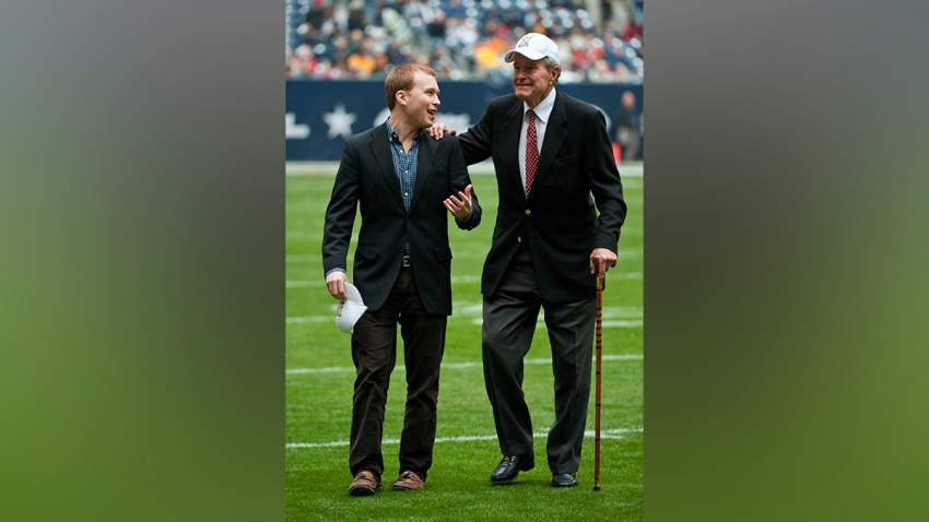 FILE - In this Dec. 31, 2009, file photo, late President George H. W. Bush, right, leaves the field alongside grandson Pierce Bush, left, before the Texas Bowl NCAA college football game in Houston. Pierce Bush announced Dec. 9, 2019, that he'll run in the Republican primary for a congressional seat near Houston.