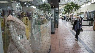A shopper wears a protective mask inside the Yuba Sutter Mall in Yuba City, California, May 13, 2020.