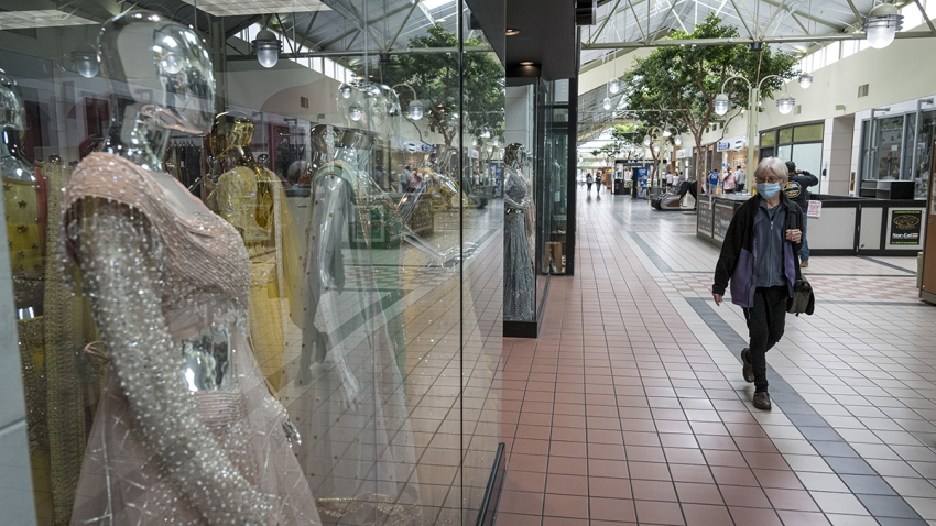 A shopper wears a protective mask inside the Yuba Sutter Mall in Yuba City, California, May 13, 2020.