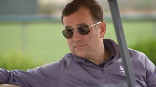 White Sox general manager Rick Hahn sits in a golf cart at the team's spring training facility in Arizona.