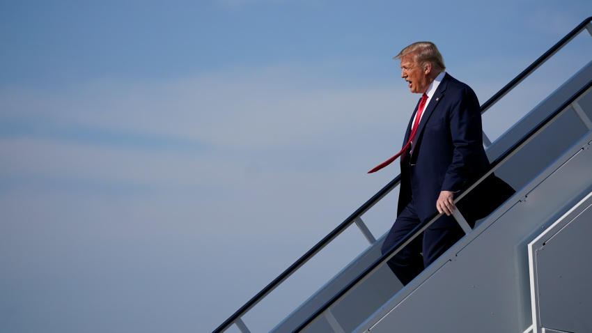 President Donald Trump exits Air Force One as he arrives at Tulsa International Airport on Saturday, June 20, 2020, in Tulsa, Okla.