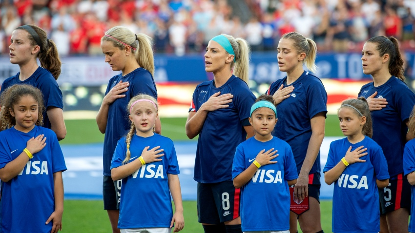 United States players Tierna Davidson, Lindsey Horan, Julie Ertz, Abby Dahlkemper, and Kelley O'Hara stand with their jerseys turned inside out during the playing of the national anthem before a SheBelieves Cup women's soccer match against Japan, Wednesday, March 11, 2020 at Toyota Stadium in Frisco, Texas.