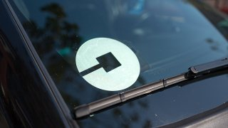 Logo for car-sharing company Uber on the passenger side windshield of a vehicle in the South of Market (SoMa) neighborhood of San Francisco, California, October 13, 2017.