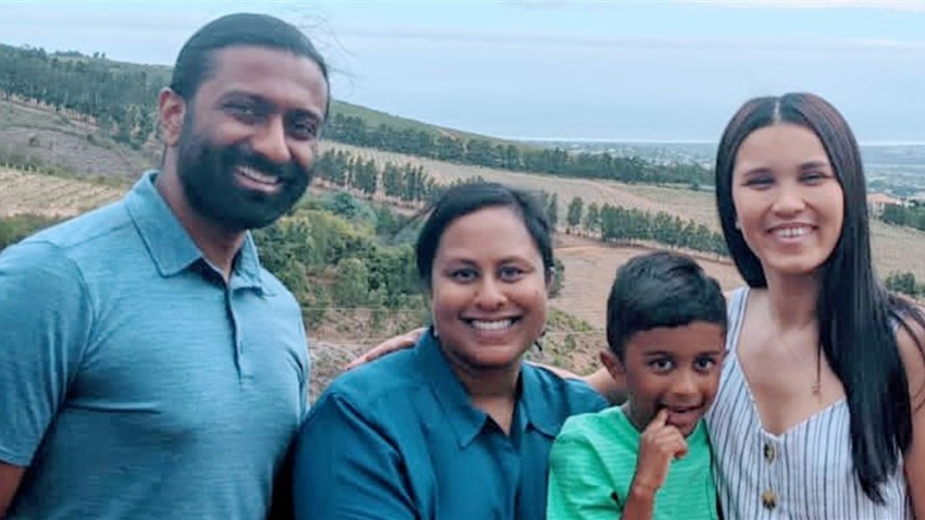 Dr. Sruthi Thomas and her family with Alex Fraser.