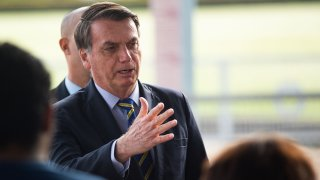 President of Brazil Jair Bolsonaro talks to supporters of his government who waited for him outside the Palácio do Alvorada amidstthe coronavirus (COVID-19) pandemic on May 6, 2020 in Brasilia.