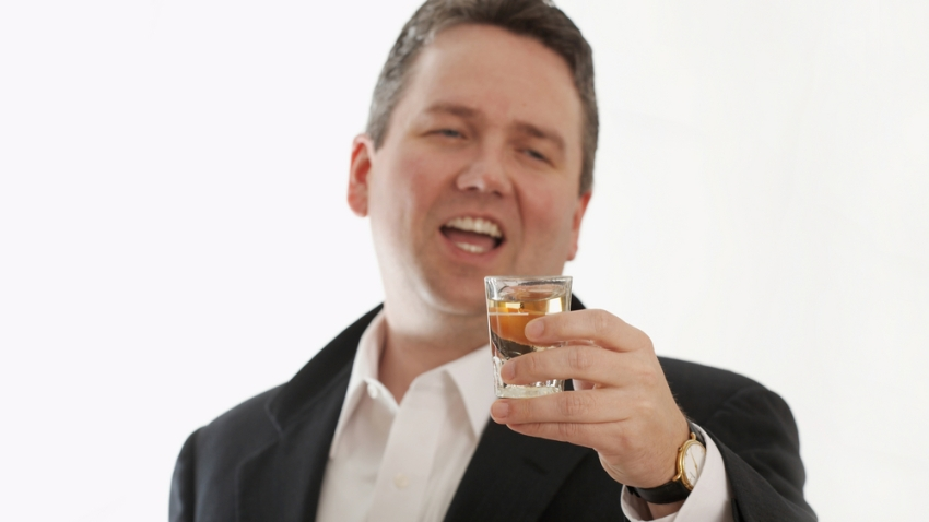 businessman with shot glass