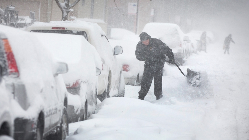 Winter Weather - Man Digging