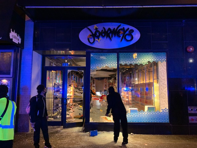 Photos Show Debris, Damaged Businesses After Looting in Downtown Chicago