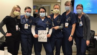 Dr. Halleh Akbarnia with some of her colleagues in the emergency room.