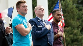 In this Sept. 11, 2015, file photo, Oregon National Guardsman Alek Skarlatos, left, U.S. Airman Spencer Stone, center, and Anthony Sadler attend a parade held to honor the three Americans who stopped a gunman on a Paris-bound passenger train, in Sacramento, California.