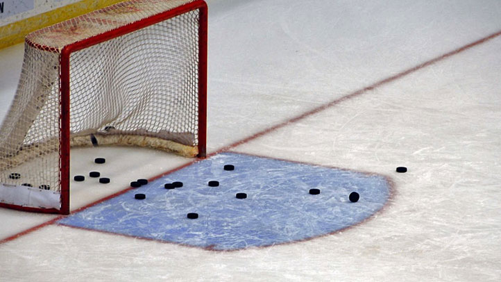 hockey-net-pucks