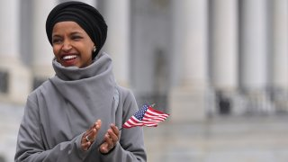 In this file photo, Rep. Ilhan Omar (D-MN) rallies with fellow Democrats before voting on H.R. 1, or the People Act, on the East Steps of the U.S. Capitol March 08, 2019 in Washington, DC.
