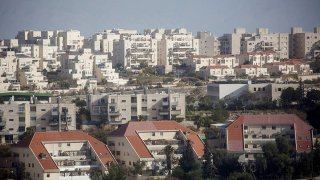 In this Jan. 16, 2017, file photo, houses part of the largest Israeli settlement of Ma'ale Adumim are seen on a hillside in Ma'ale Adumim, West Bank.