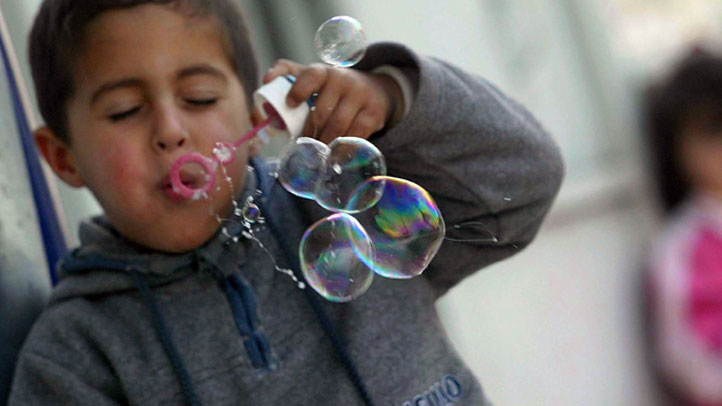 kid-blowing-bubbles
