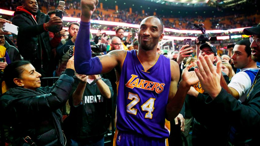 Los Angeles Lakers' Kobe Bryant acknowledges the crowd as he leaves the court after their 112-104 win over the Boston Celtics in his final regular season NBA basketball game in Boston, Dec. 30, 2015.