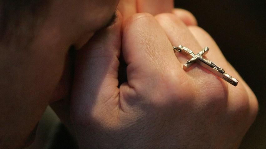prayer man praying rosary