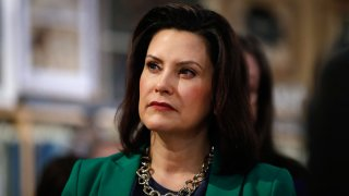 In this March 18, 2019, file photo, Michigan Gov. Gretchen Whitmer listens to Democratic presidential candidate Sen. Kirsten Gillibrand, D-N.Y., in Clawson, Mich. Whitmer is moving to make Michigan the first state to ban flavored e-cigarettes.