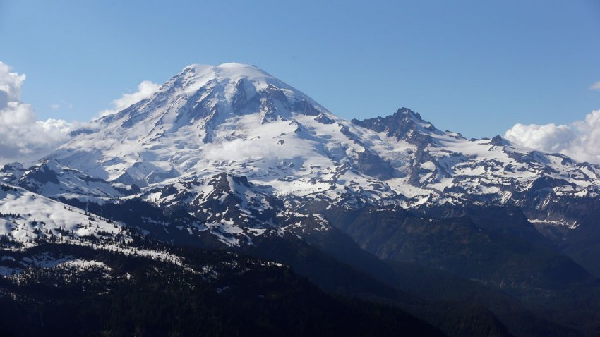 In this file photo taken June 19, 2013, Mount Rainier is seen from a helicopter flying south of the mountain and west of Yakima, Washington.