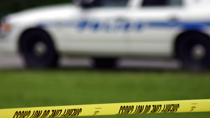 police-tape-day-SHERIFF-shutterstock_50114012