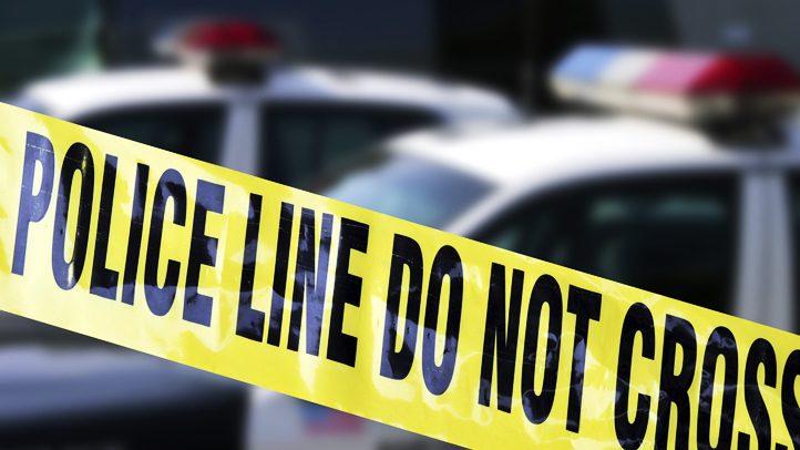 police-tape-day-shutterstock_8128183