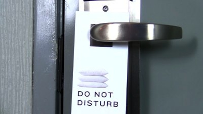 stock-footage-do-not-disturb-hotel-sign-hanging-from-door-hd