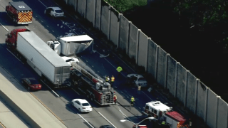 photo shows aftermath of crash involving box truck and car on I-294