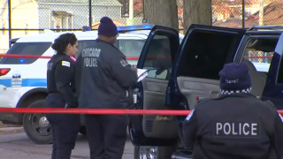 Chicago police investigate the shooting of a 21-year-old woman in Brighton Park on Thursday