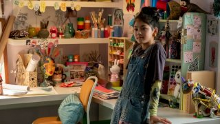 """This image released by Netflix shows Momona Tamada portraying Claudia Kishi in a scene from the Netflix series """"The Baby-Sitters Club"""""""