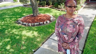 """Parent and teacher Stacey Pugh poses for a photograph outside her home Monday, July 13, 2020, in Humble, Texas. While children have proven to be less susceptible to the coronavirus, teachers are vulnerable. """"I will be wearing a mask, a face shield, possibly gloves, and I'm even considering getting some type of body covering to wear,"""" says Pugh, a fifth-grade teacher in suburban Houston."""