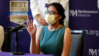Mayra Ramirez, a COVID-19 survivor due to a double-lung transplant, responds Thursday, July 30, 2020, to a question about her journey through the pandemic during her first news conference at Northwestern Memorial Hospital in Chicago. Ramirez is the first known patient in the United States who received double-lung transplants due to COVID-19.