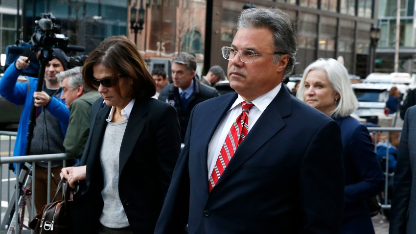 Manuel, right, and Elizabeth Henriquez leave the John Joseph Moakley United States Courthouse in Boston on April 3, 2019. 13 parents were scheduled to appear in federal court in Boston Wednesday for the first time since they were charged last month in a massive college admissions cheating scandal. They were among 50 people - including coaches, powerful financiers, and entrepreneurs - charged in a brazen plot in which wealthy parents allegedly schemed to bribe sports coaches at top colleges to admit their children. Many of the parents allegedly paid to have someone else take the SAT or ACT exams for their children or correct their answers, guaranteeing them high scores. (Photo by Jessica Rinaldi/The Boston Globe via Getty Images)
