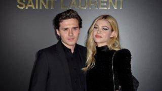 Brooklyn Beckham and Nicola Peltz attend the Saint Laurent fashion show.