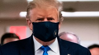 In this July 11, 2020, file photo, President Donald Trump wears a mask as he visits Walter Reed National Military Medical Center in Bethesda, Maryland.