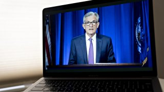 Jerome Powell, chairman of the U.S. Federal Reserve, speaks during a virtual news conference seen on a laptop computer in Arlington, Virginia, U.S., on Wednesday, July 29, 2020. Federal Reserve officials left their benchmark interest rate unchanged near zero and again vowed to use all their tools to support the U.S. economy amid a shaky recovery from the coronavirus pandemic.