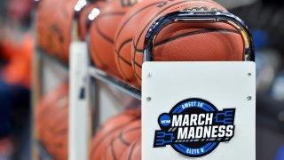 a rack of basketballs