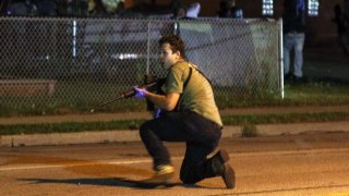 In this file photo, Kyle Rittenhouse is pictured during the third day of protests over the shooting of a black man Jacob Blake by police officer in Wisconsin, United States on August 25, 2020. Rittenhouse, the Illinois man accused of killing two people during the chaotic protests, was due Friday, May 21, 2020, to make his first in-person court appearance.