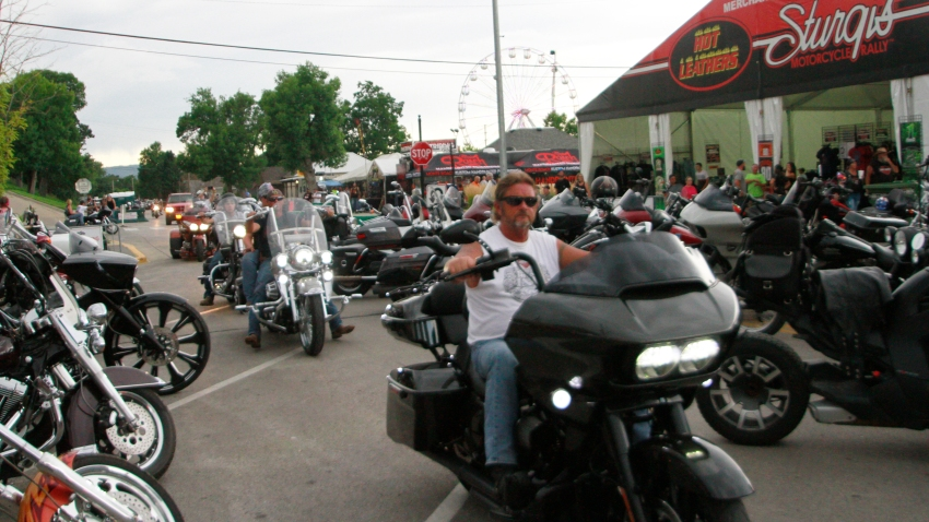 Bikers ride through downtown Sturgis, S.D., on Friday, Aug. 7, 2020
