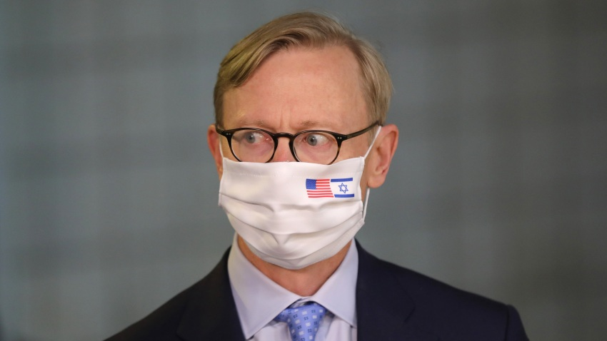 US special representative for Iran Brian Hook wears a face mask against Covid-19, bearing the US and Israeli flags, during a meeting with the Israeli prime minister in Jerusalem on June 30, 2020.