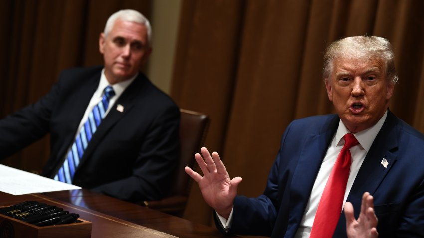 US President Donald Trump speaks next to US Vice President Mike Pence(L) before signing an Executive Order on Hiring American at the White House on August 3, 2020 in Washington,DC. - The Executive Order follows his Buy American, Hire American Executive Order from April 2017 and takes further action to prevent Americans from being displaced by foreign workers.