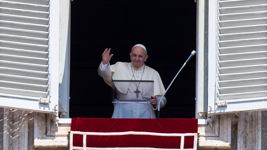 Pope Francis waves at faithfuls from the window of the apostolic palace overlooking St.Peter's square during his Angelus prayer on August 15, 2020 at the Vatican.