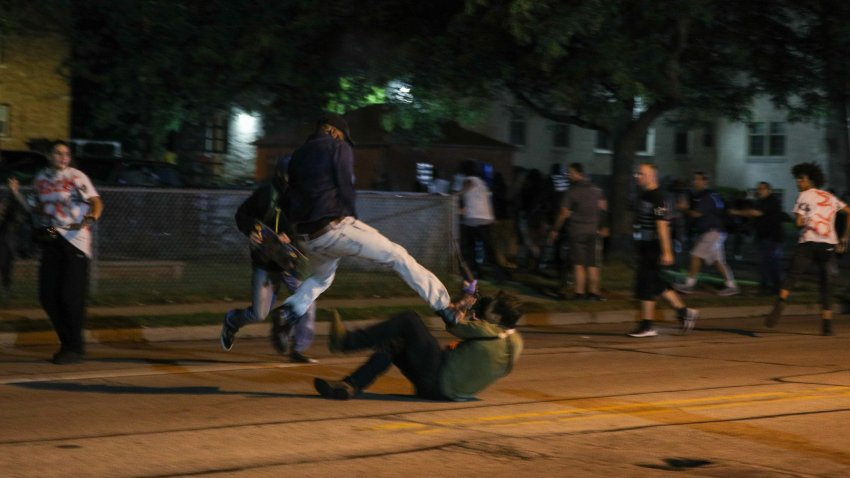 Clashes between protesters and armed civilians, who protect the streets of Kenosha against the arson, break out during the third day of protests over the shooting of a black man Jacob Blake by police officer in Wisconsin