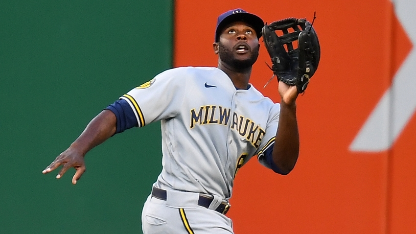 Brewers outfielder Lorenzo Cain chases down a fly ball in a game against the Cardinals