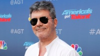 Simon Cowell Speaks Out After Breaking His Back in Bike Accident